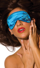 Luscious blue brocade blindfold. Back side is felt lined. Has an elastic band that goes around the head.