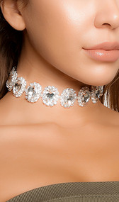 "Emerald cut rhinestone choker with adjustable lobster clasp closure. Measures about 1"" tall."