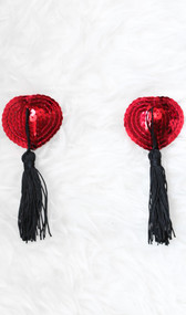 Sequin heart shaped pasties with tassel detail. Self adhesive. Pair.