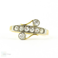 Art Nouveau Diamond Ring, Old European Cut Diamonds in Asymmetrical Design Line & Bezel Setting Milgrain Beading. 18ct Platinum, Circa 1910s.