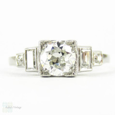 Art Deco Diamond Engagement Ring, Old European Cut Diamond with Straight Cut Baguettes. Circa 1930s, 0.84 ctw, Marked PLAT.