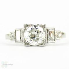 Art Deco Old European Diamond Engagement Ring with Baguettes. Circa 1930s, Platinum.