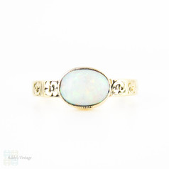 Antique Opal Ring, Bezel Set Oval Cabochon. Engraved Floral Band, 14k, Circa 1900.