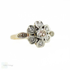 Floral Diamond Cluster Engagement Ring with Heart Petals. Circa 1940s, 18ct & Plat.