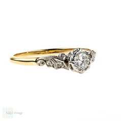 Round Brilliant Diamond Engagement Ring with Scrolled Setting. Circa 1940s, 18ct Gold & Platinum.