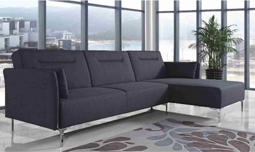 This is grey fabric sofa sectional features an easy to convert bed.