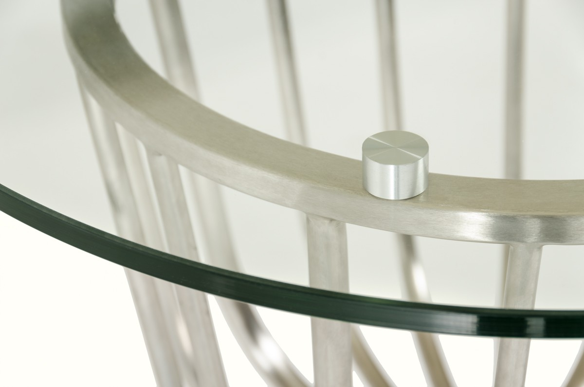 close up shot of a round glass top bar table