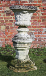 Classical antique cast stone planter urn on plinth