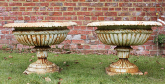 Classical pair of cast iron planters urns