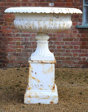 Huge classical cast iron planter on plinth urn