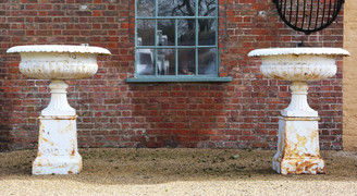 Huge classical pair of cast iron planters urns on plinths