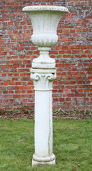 Cast stone planter urn on plinth column pedestal
