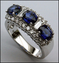 3 Stone Sapphire Ring with .84ct F Color Diamonds