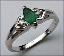 3 Stone Marquise Emerald and Diamond Ring