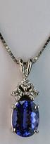 Oval Tanzanite Pendant with Three Diamonds