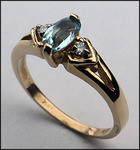 14kt Gold Blue Topaz and Diamond Ring R642