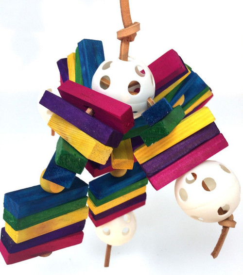 1351 Stick Ball is a feast of color, it consists of over 30 small colorful square wood chew pieces threaded through with leather and plastic Wiffle balls.