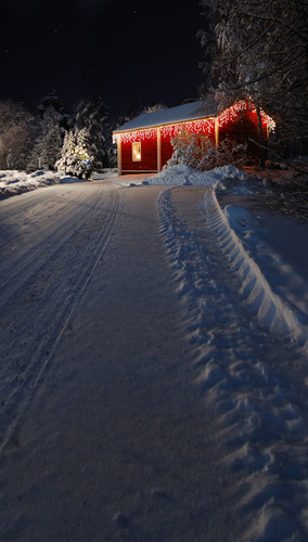 Lighted Red Christmas Cabin at Night