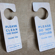 """Wooden """"Do Not Disturb"""" Door hanger signs.  Hook fixings.  Sign is light oak stained pine with white wash and printed graphics.  Can be personalised."""