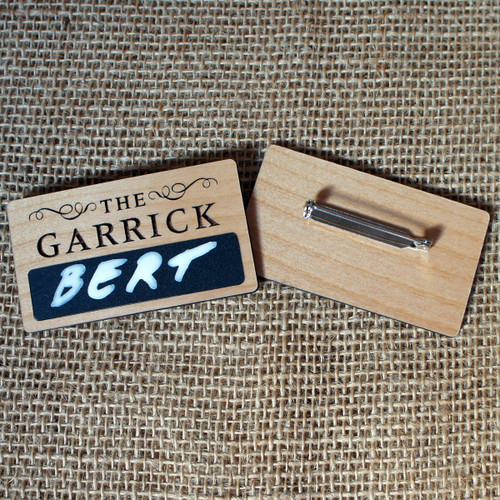 Engraved wooden badges with chalkboard area and engraved company logo