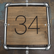 Wooden distressed engraved sign with galvanised frame surround for industrial-look sign