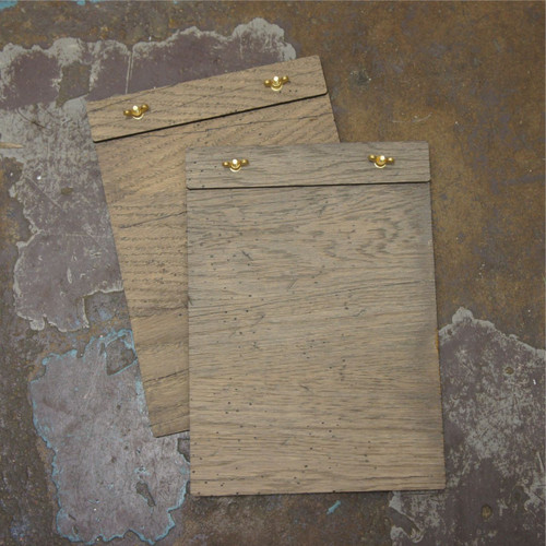 """Wooden wingnut clipboard (unbranded) with rustic grey / silver look wood.  Clamp to the top with brass wingnut fixings.  Available in both distressed and plain wood in sizes to suit DL, A5 and A4 paper. Example shown is the """"distressed wood"""" option."""
