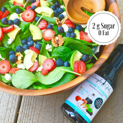 Spinach, berries, and almond salad topped with Simple Girl's organic, low-sugar, and 10 calorie Balsamic Vinaigrette dressing. Yum!