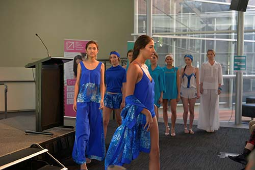 Models on stage showing the Rosalbah Pacific Dreams Collection to the audience