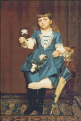 Daisy Mccomb Holding a  Rose