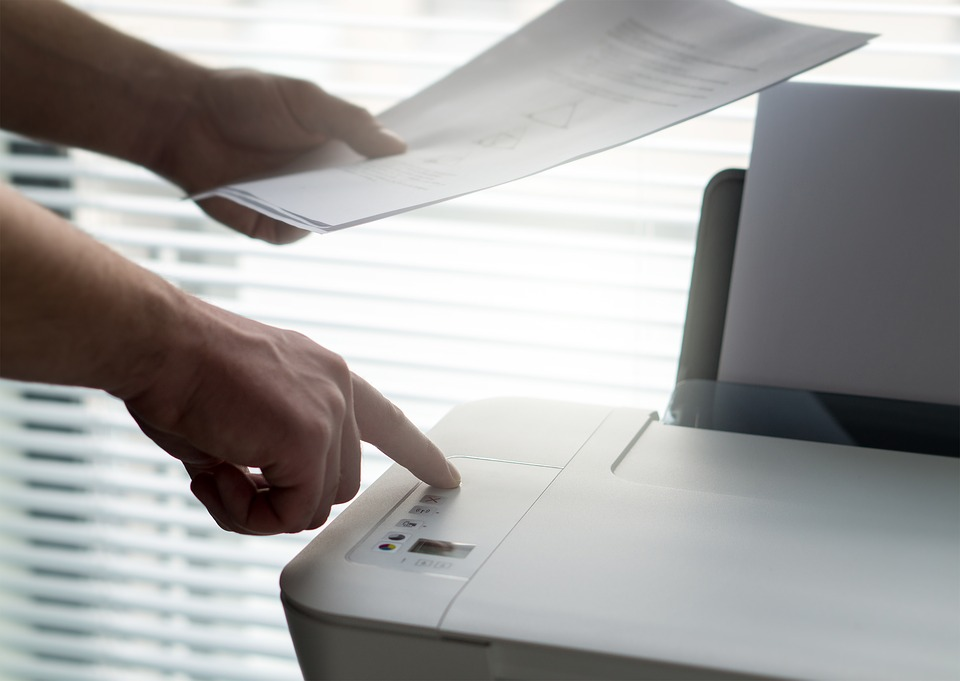 person using an inkjet printer at work