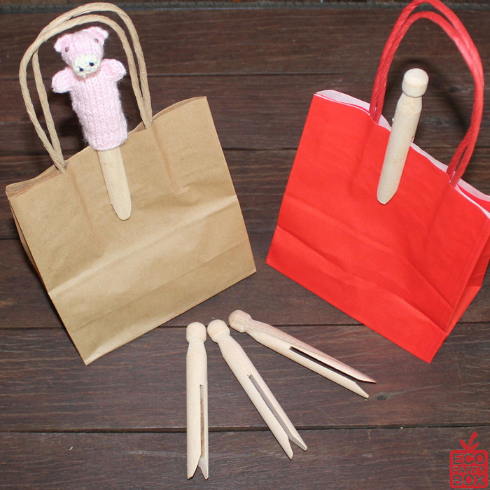 Our Wooden Dolly Pegs measure 11cm high and are perfect for securing our range of paper eco party bags.
