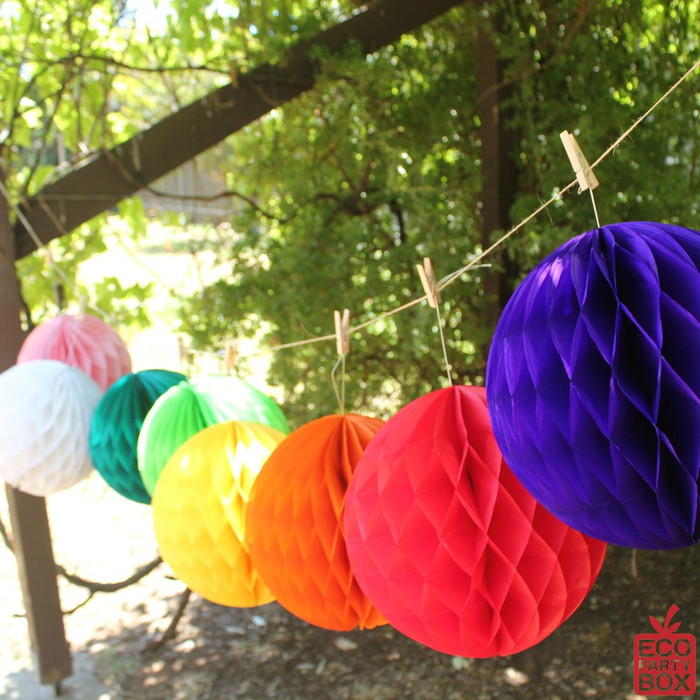 """Our 10"""" Honeycomb Tissue Pom Poms are really easy to assemble and look fantastic hung up. They can be used again and again."""