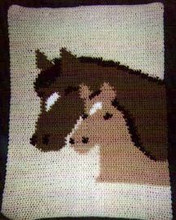"""Horses Crochet Afghan Graph Pattern.  All done in single crochet, changing colors as you go along.  Drop one color, pull in the next.  Medium ability.  Size works up to be approx. 50 x 70"""".  Graph is 64 stitches wide by 104 stitches high.  Then you crochet 22 rows (or more) around the outside edge including a border.  Complete instructions are included, a full size graph, and a Helpful Hints page."""