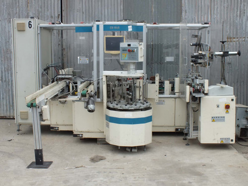 Gima CD840 DISK PACKER MACHINE WITH LABELER. CD-840