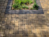 Fertilizer Rust Stains over colored pavers removed with SealGreen Rust  Remover