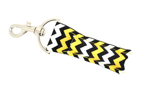 Black, Yellow, and White Chevron     This lip balms holder is very durable with a stainless steel hook that is easily attached and unattached to a purse, keys, backpack, or lanyard.