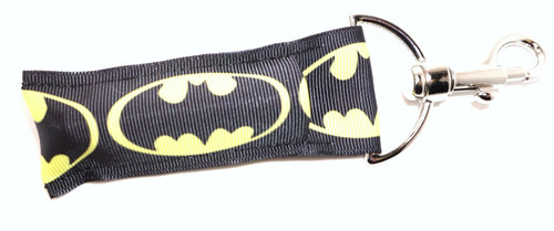 Batman Lip Balm Holder   This lip balms holder is very durable with a stainless steel hook that is easily attached and unattached to a purse, keys, backpack, or lanyard. This lip balm holder has multiple Superhero logo's .  Superhero logo's on this holder:  Batman  MADE IN THE USA!!