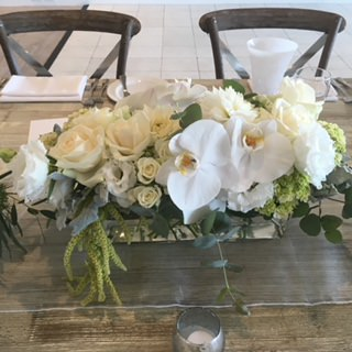 table-centrepiece-white-natural-roses-hydragea-orchid.jpg