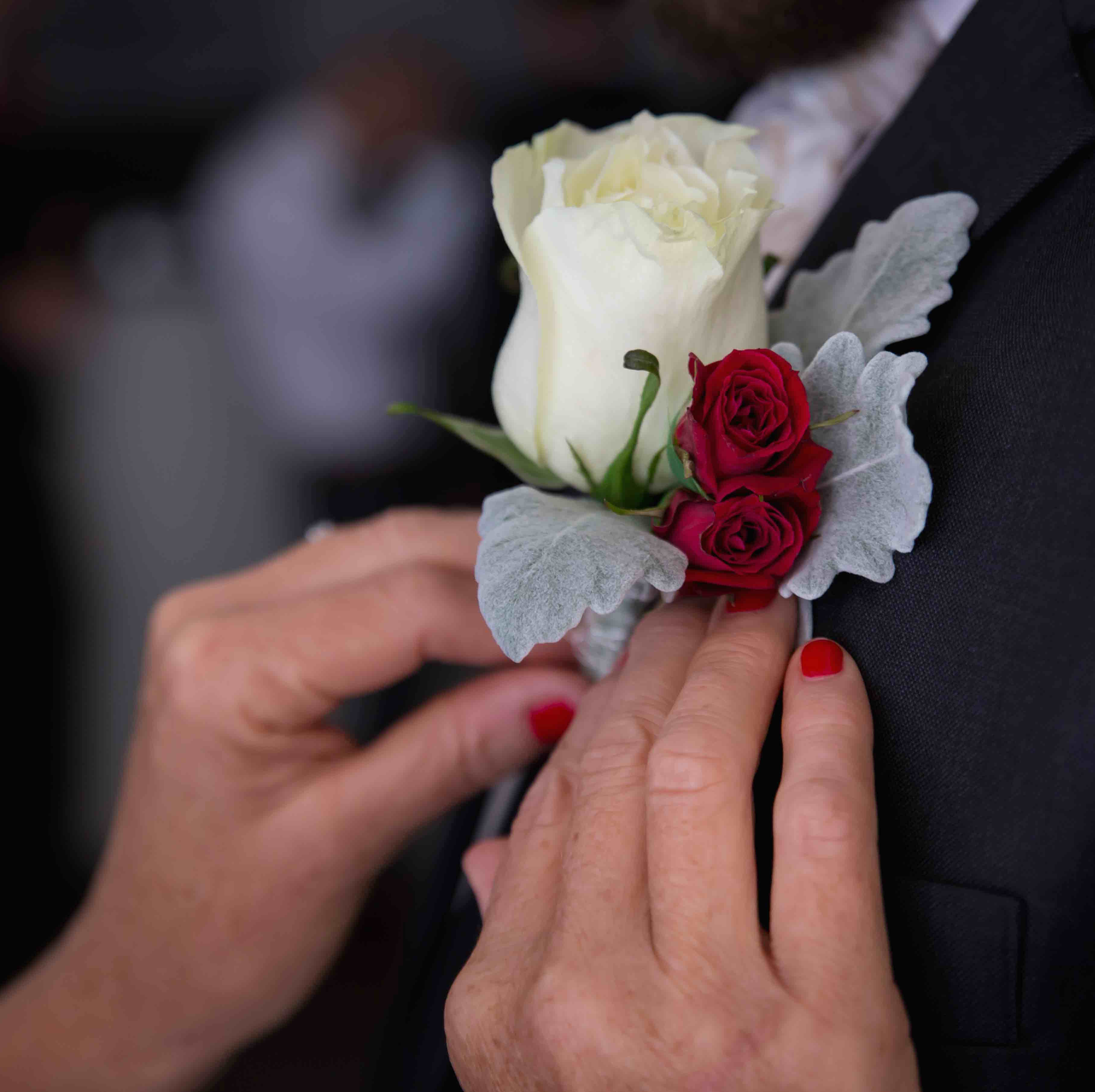 white-red-rose-buttonhole-groom.jpg