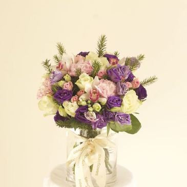 Purple pink and white florals in a vase