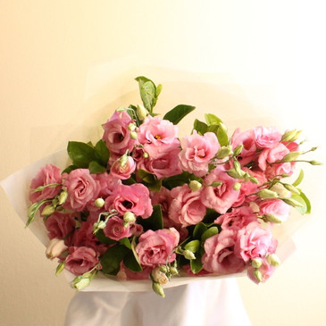 A bunch or bouquet of one type of flower - rose tulip carnation lily freesia