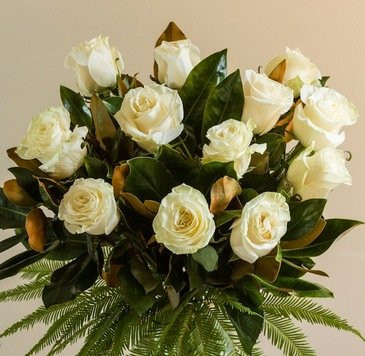 White red pink creme orange long stemmed Columbian rose bouquet with greenery