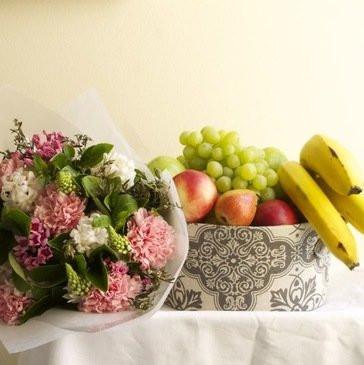 Fruit hamper and flower posy gift basket