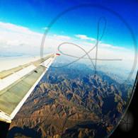 Mountain Road Airplane Window View