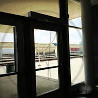 Burlington Station Sign through Glass Door