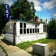Maidrite Building Eat Sign