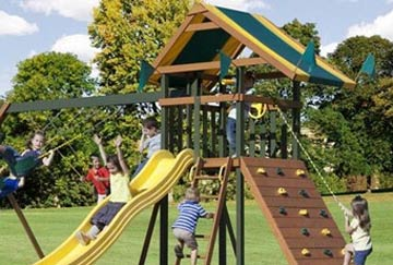 A group of young children play on a Boredom Buster swing set