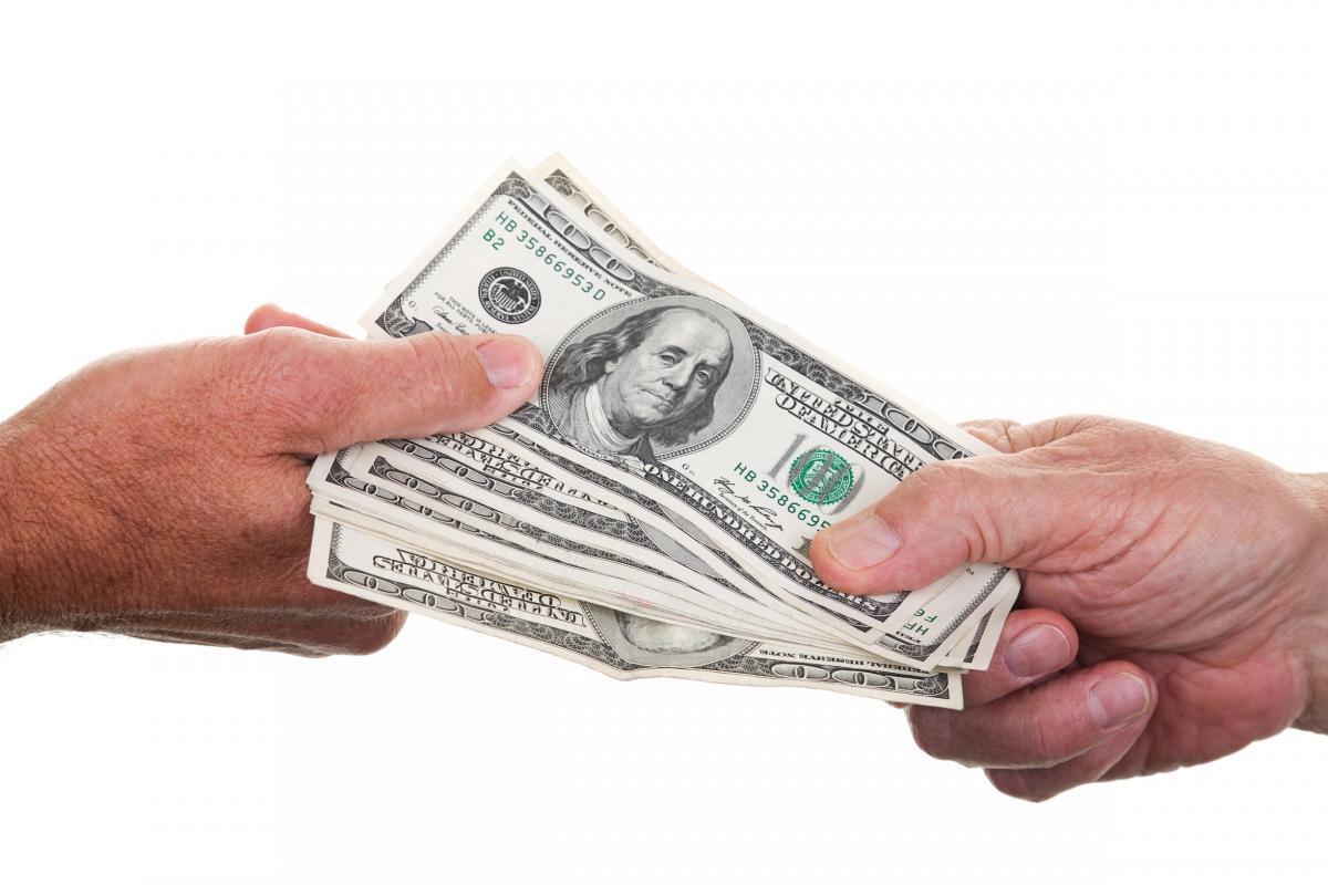 money-changing-hands.jpg