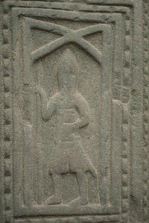 church grave slab of a kilted warrior