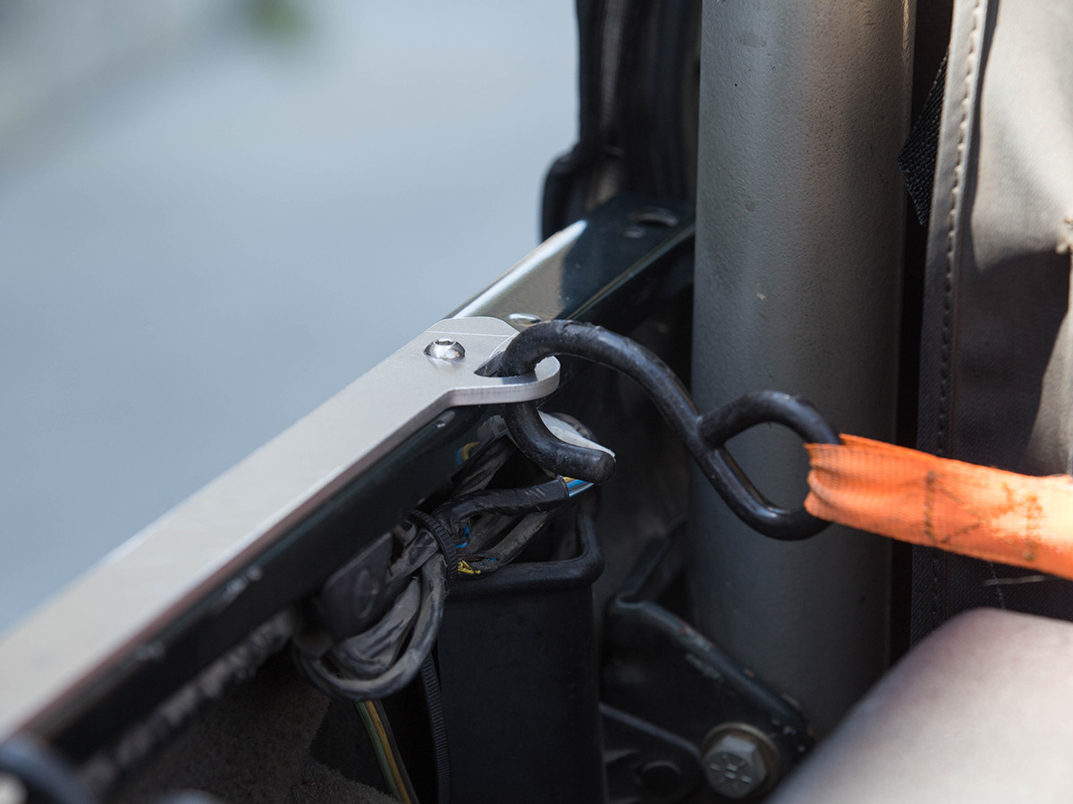 GenRight Jeep Bed Rail Tie Down, using a ratchet strap tie down.